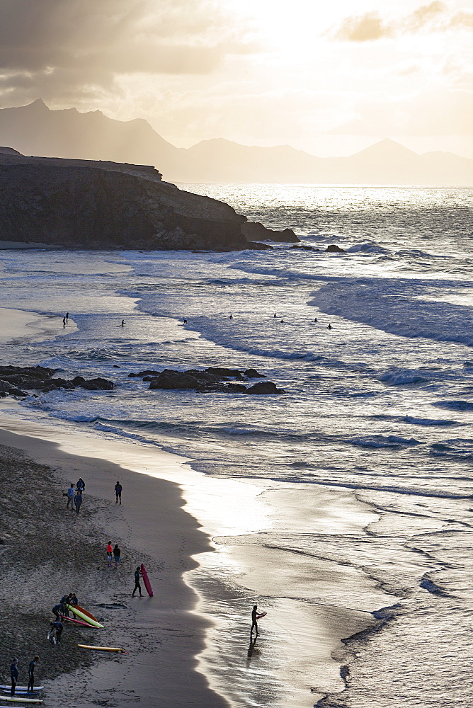 Surfers on Playa del Viejo Rey near La Pared on the volcanic island of Fuerteventura, Canary Islands, Spain, Atlantic, Europe - 785-2261