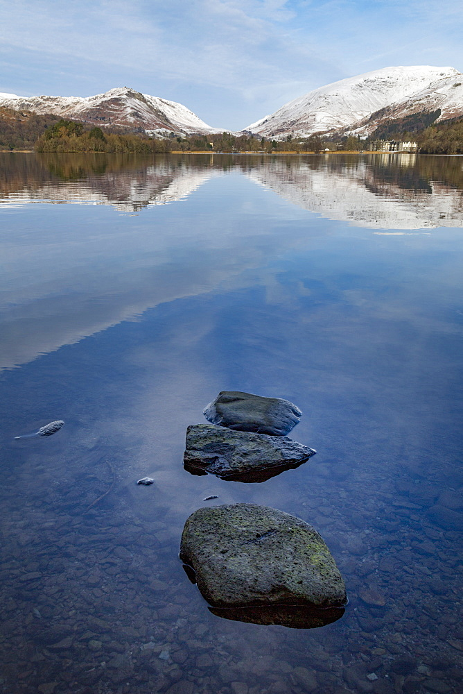 Stones in shallow water and perfect reflection of snow covered mountains and sky in the still waters of Grasmere, Lake District National Park, UNESCO World Heritage Site, Cumbria, England, United Kingdom, Europe - 785-2332