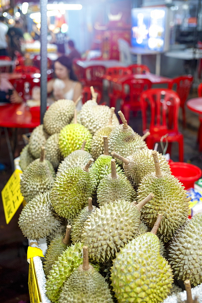 A display of Durian fruit for sale in Bukit Bintang food street at night in the capital city of Kuala Lumpur