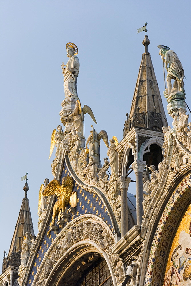 St. Mark and angels, detail of the facade of Basilica di San Marco (St. Mark's Basilica), St. Mark's Square, Venice, UNESCO World Heritage Site, Veneto, Italy, Europe