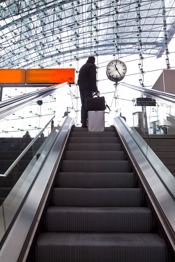 Escalator and platform clock at modern train station, Berlin, Germany, Europe