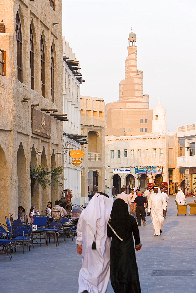 The restored Souq Waqif looking towards the spiral mosque of the Kassem Darwish Fakhroo Islamic Centre based on the Great Mosque in Samarra in Iraq, Doha, Qatar, Middle East