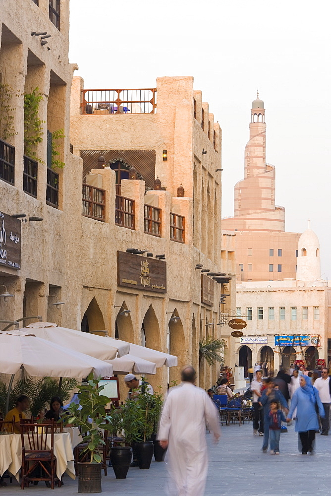 The restored Souq Waqif looking towards the spiral mosque of the Kassem Darwish Fakhroo Islamic Centre based on the Great Mosque in Samarr in Iraq, Doha, Qatar, Middle East