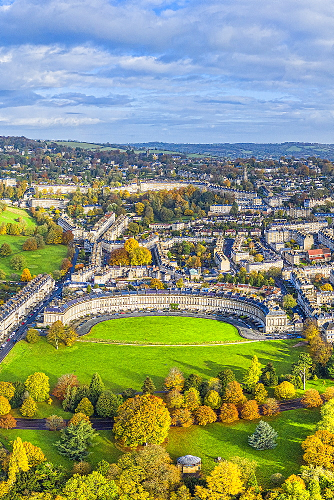 Aerial view by drone over the Georgian city of Bath, Royal Victoria Park and Royal Cresent, UNESCO World Heritage Site, Bath, Somerset, England, United Kingdom, Europe