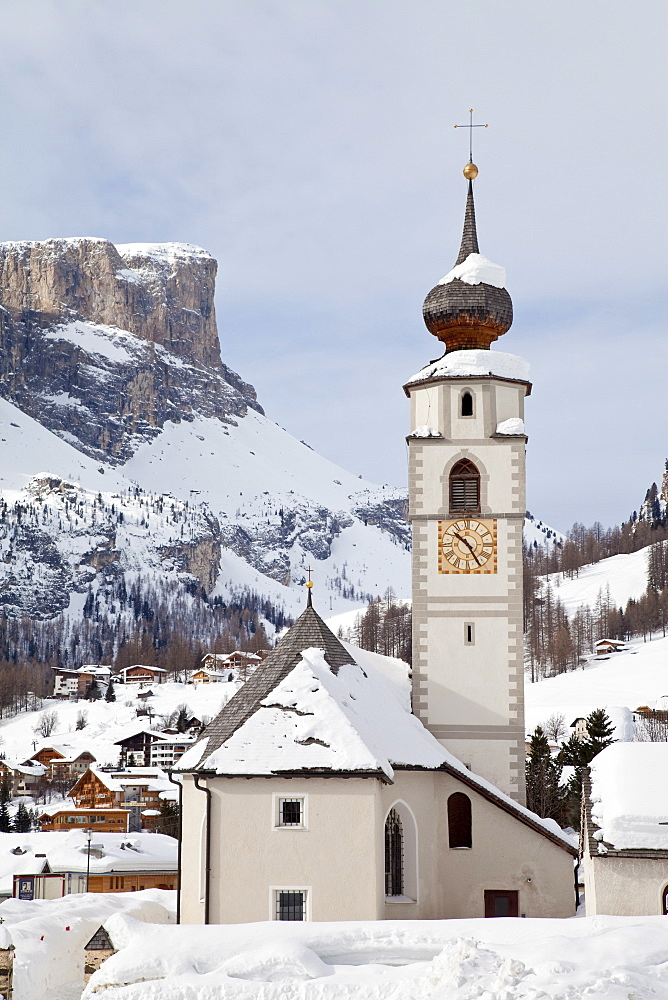 The church and village of Colfosco in Badia, 1645m, and Sella Massif range of Mountains under winter snow, Dolomites, South Tirol, Trentino-Alto Adige, Italy, Europe - 794-851