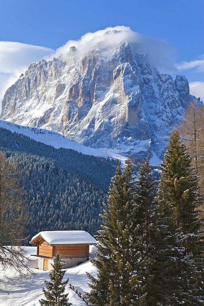 Winter snow covered mountain hut in front of Sassolungo mountain, 3181m, Val Gardena, Dolomites, South Tirol, Trentino-Alto Adige, Italy, Europe - 794-871
