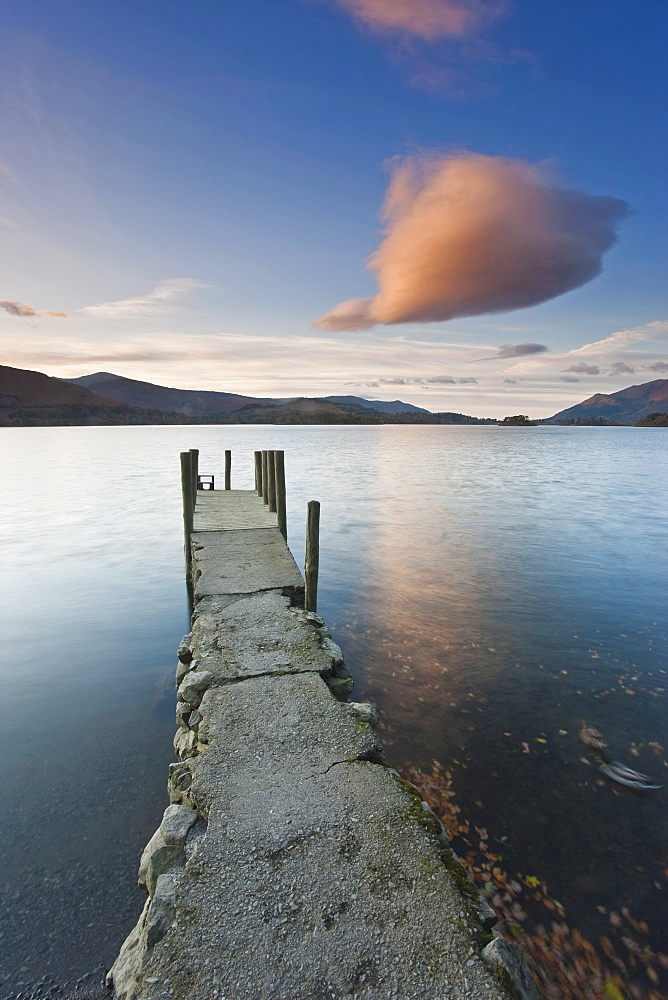 Cloud formation and wooden jetty at Barrow Bay landing, Derwent Water, Lake District National Park, Cumbria, England, United Kingdom, Europe