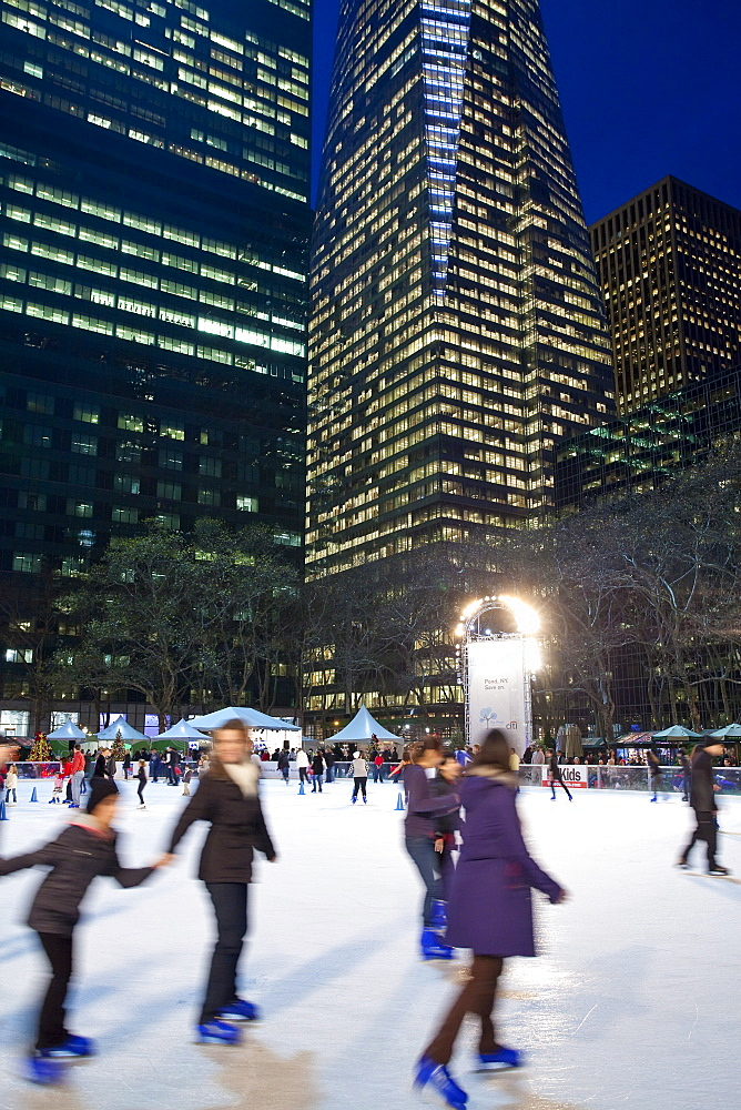 Ice skating rink in Bryant Park at Christmas, Manhattan, New York City, New York, United States of America, North America