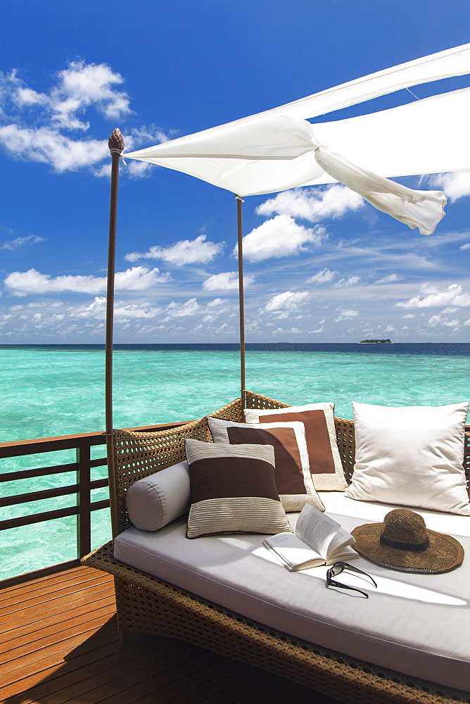 Sofa overlooking ocean, Maldives, Indian Ocean, Asia - 795-528