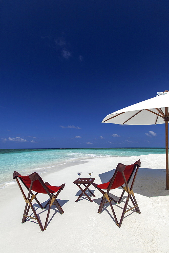 Martini and chairs on the beach, Maldives, Indian Ocean, Asia - 795-531