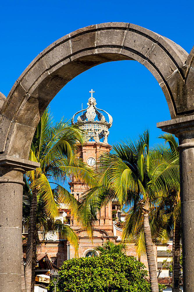Our Lady of Guadalupe church through the Malecon arches, Puerto Vallarta, Jalisco, Mexico.