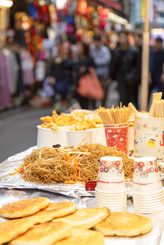 Fried noodles in Myeongdong market, Seoul, South Korea, Asia