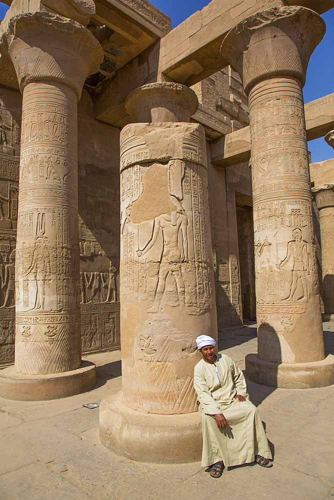 Caretaker, Columns with Reliefs, Temple of Sobek and Haroeris, Kom Ombo, Egypt, North Africa, Africa