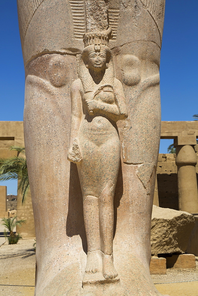 Statue of Nefetari, at base of statue of Ramses II, Great Court, Karnak Temple Complex, UNESCO World Heritage Site, Luxor, Thebes, Egypt, North Africa, Africa - 801-3008