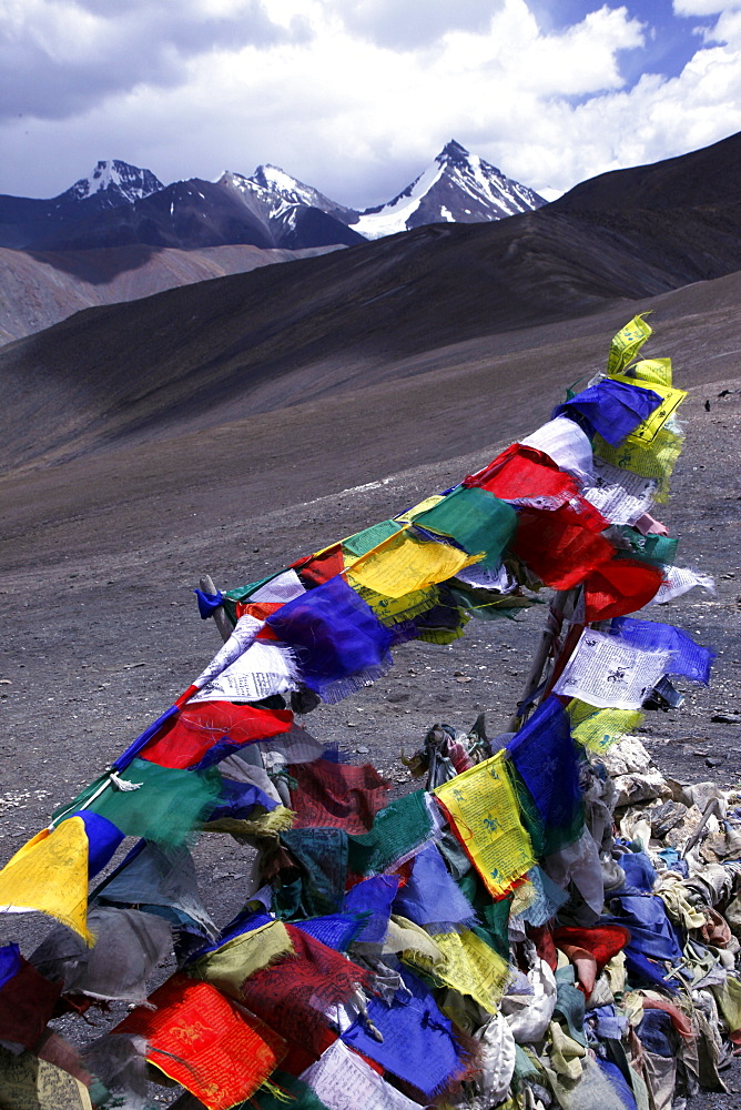 Prayer flags on a stupa high in the Zanskar Range, Ladakh, Himalayas, India, Asia