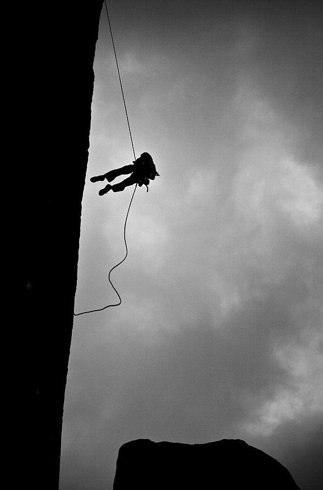 Climber abseiling off a wall, Tsaranoro Massif, southern Madagascar, Africa - 802-546