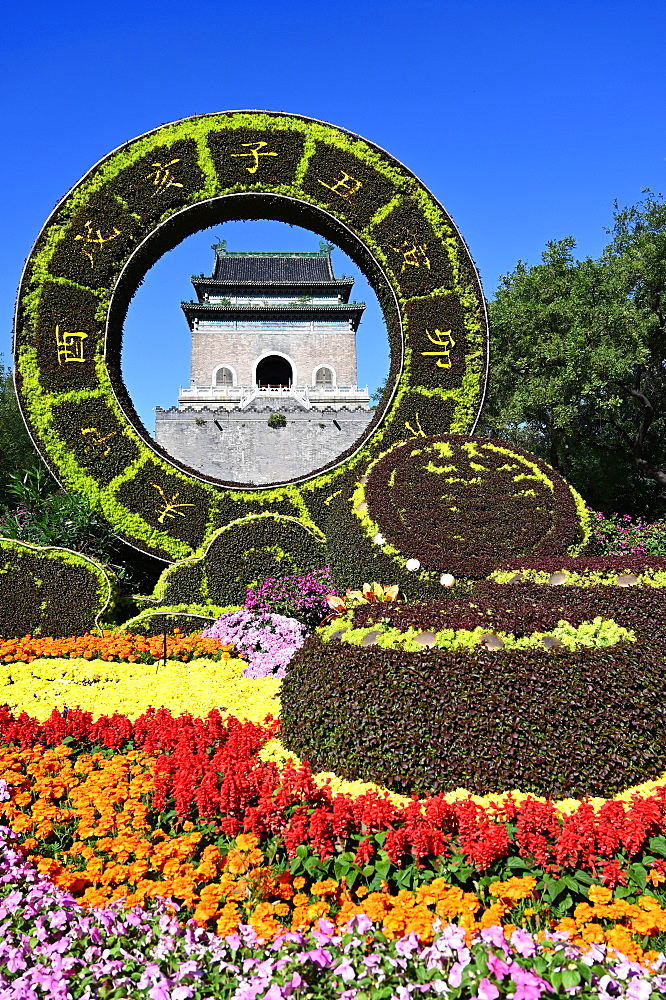 Elaborate floral decorations celebrating 70 years of China framing the Bell Tower, built in 1272, Beijing, China