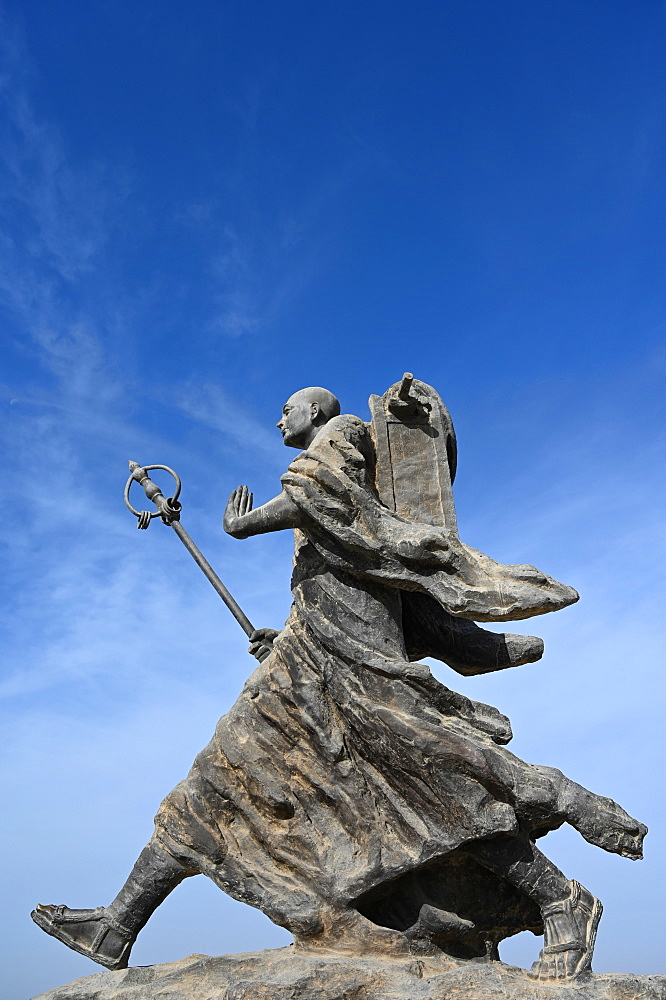 Statue of 7th century monk, Xuanzang, carrying Buddhist sutras, Gaochang ruins, Xinjiang, China, Asia
