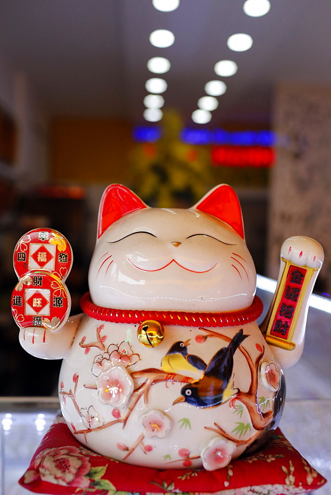 Lucky Cat in shop Symbolizing good luck and good fortune. Ho Chi Minh City. Vietnam.