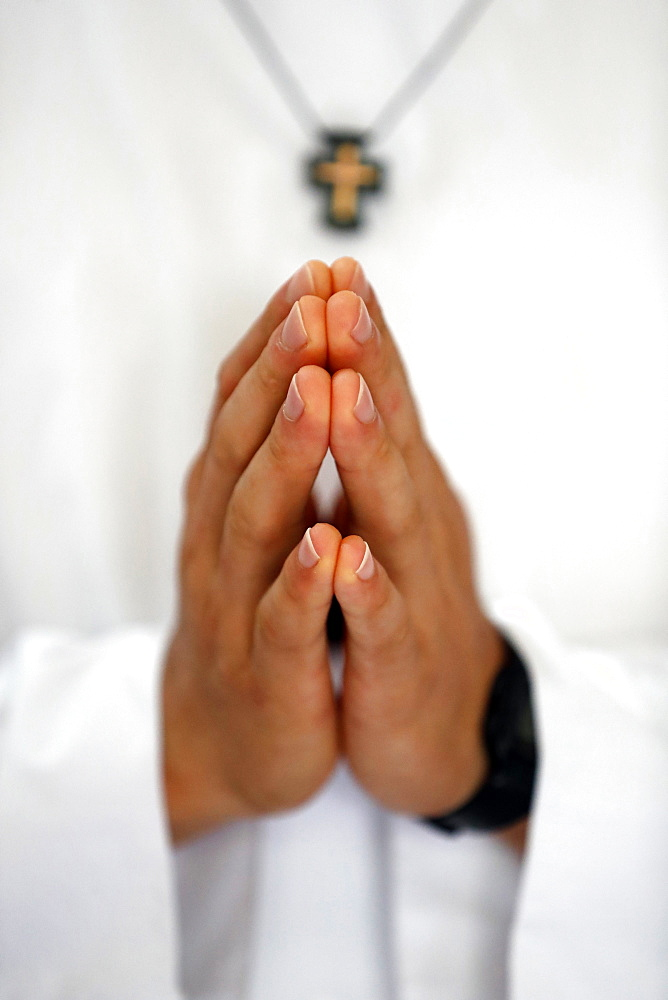 Close up of Monk's hands praying in church, Cistercian Abbey, Our Lady of My Ca, Vietnam, Indochina, Southeast Asia, Asia