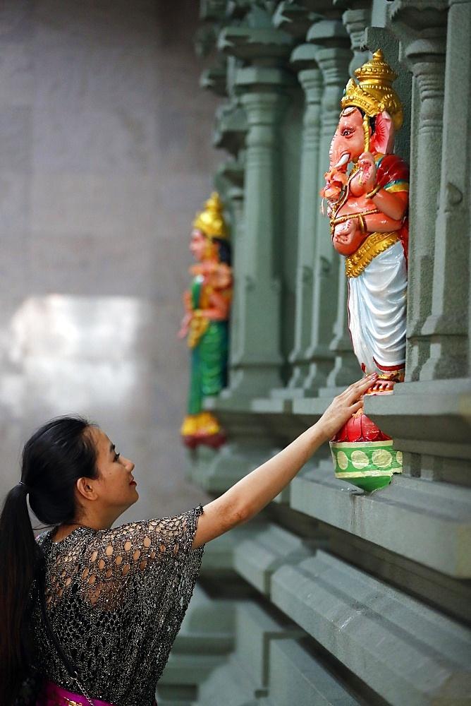 Woman praying to Hindu deity Ganesh, Sri Mahamariamman Hindu Temple, Kuala Lumpur, Malaysia, Southeast Asia, Asia