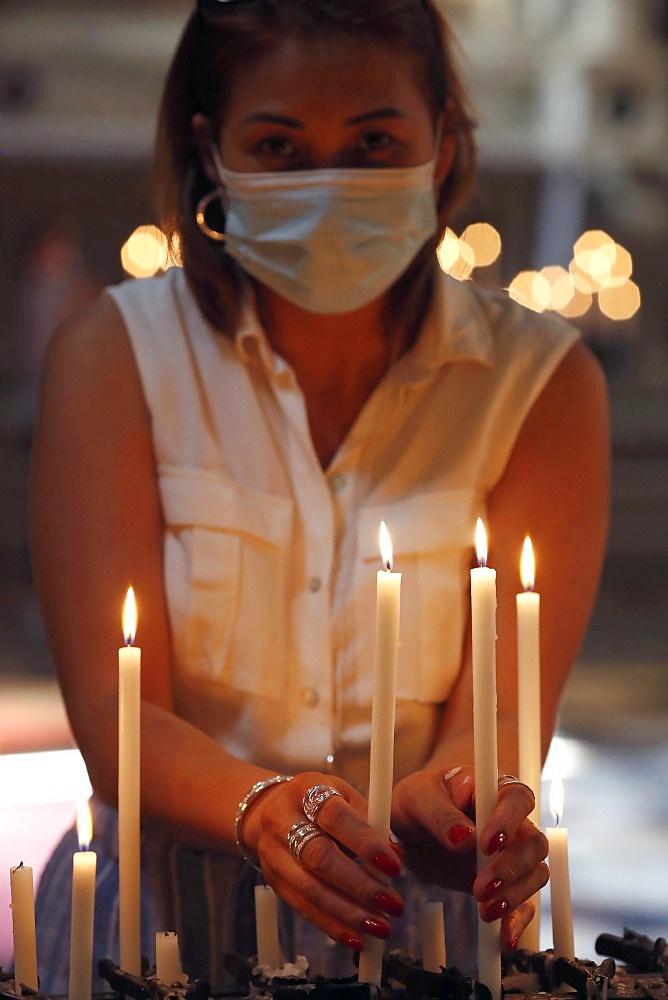 Woman with face mask praying in church during coronavirus epidemic, Venice, Veneto, Italy, Europe - 809-8184
