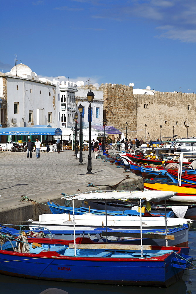 Fishing boats, old port canal with kasbah wall in background, Bizerte, Tunisia, North Africa, Africa - 813-126