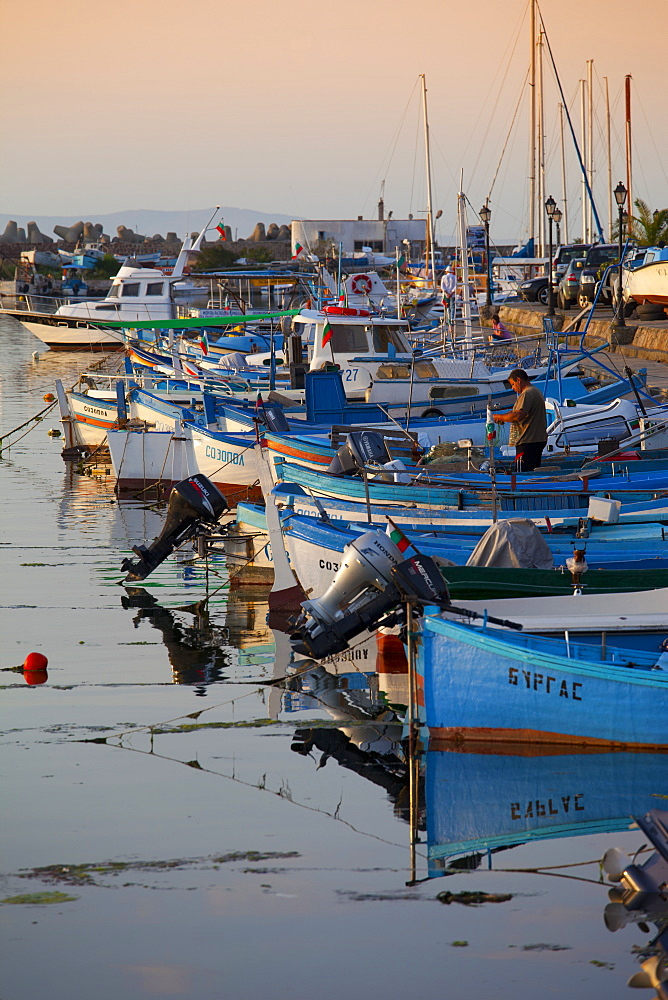 Line of fishing boats at dusk in the harbour, Sozopol, Black Sea, Bulgaria, Europe - 813-270