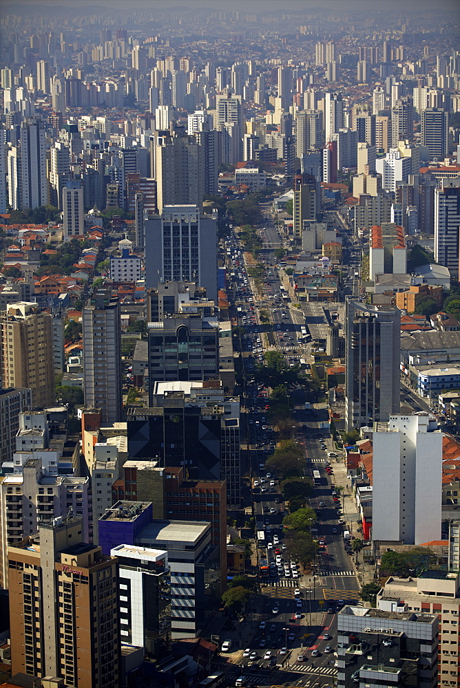 View over Sao Paulo skyscrapers and traffic jam from taxi helicopter, Sao Paulo, Brazil, South America