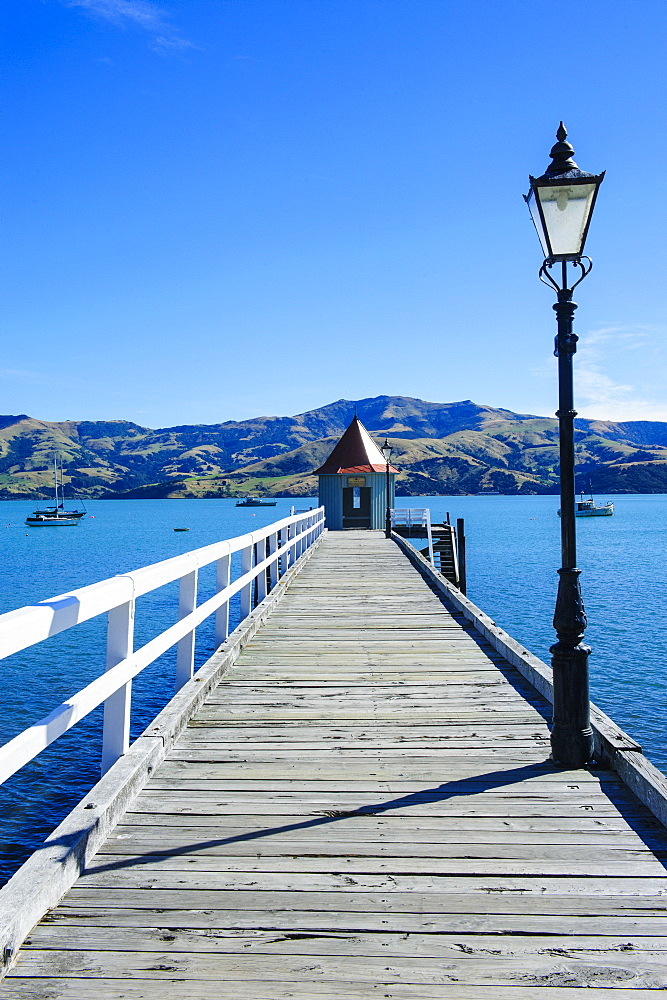 Long wooden pier in Akaroa, Banks Peninsula,Canterbury, South Island, New Zealand, Pacific