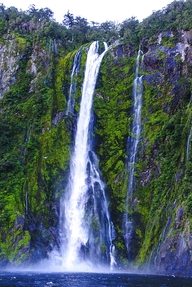 Huge waterfall in Milford Sound, Fiordland National Park, UNESCO World Heritage Site, South Island, New Zealand, Pacific
