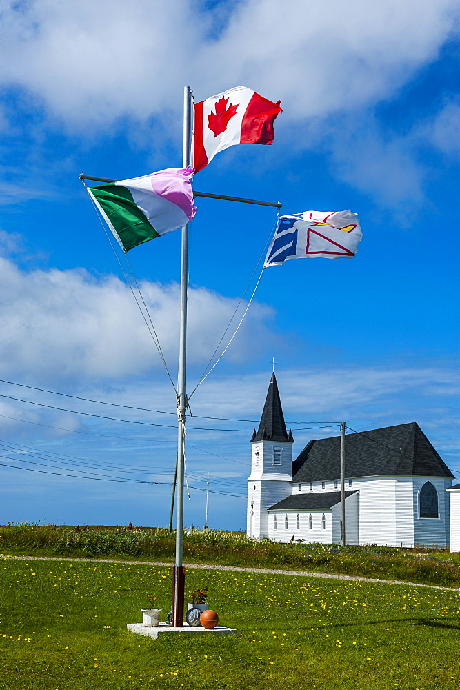 Flag pole in front of a church in Flower Cove, Newfoundland, Canada, North America