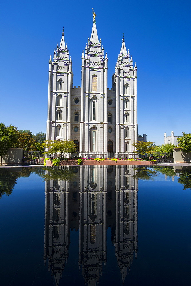Mormon Salt Lake Temple reflecting in a little pond, Salt Lake City, Utah, United States of America, North America