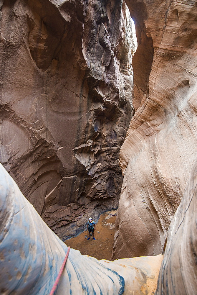 Man standing in a slot canyon after canyoneering, Moab, Utah, United States of America, North America