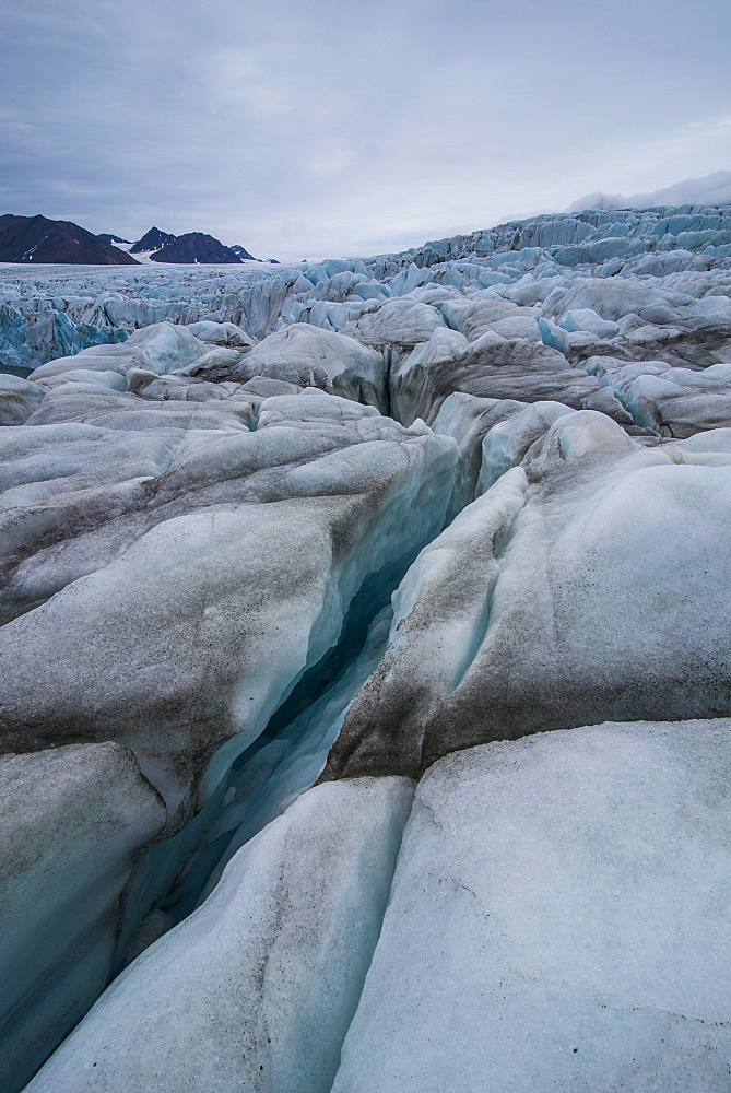 Large ice crack in a huge glacier in Hornsund, Svalbard, Arctic