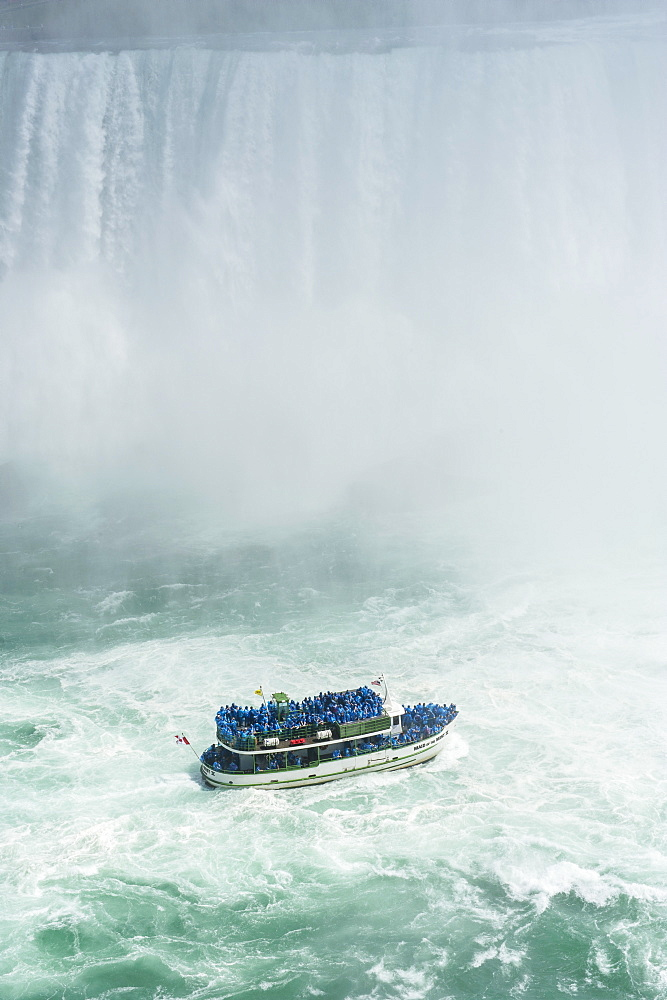 Tourist boat in the mist of the Horseshoe Falls (Canadian Falls), Niagara Falls, Ontario, Canada, North America