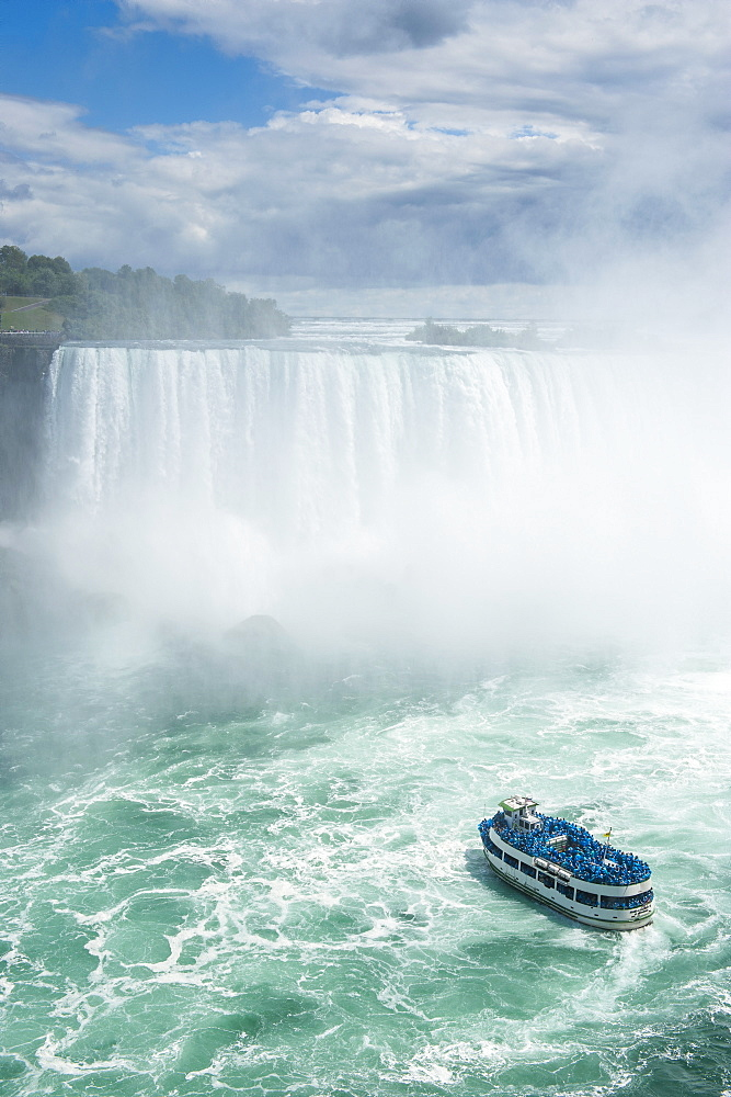 Tourist boat in the mist of the Horseshoe Falls, or Canadian Falls, Niagara Falls, Ontario, Canada