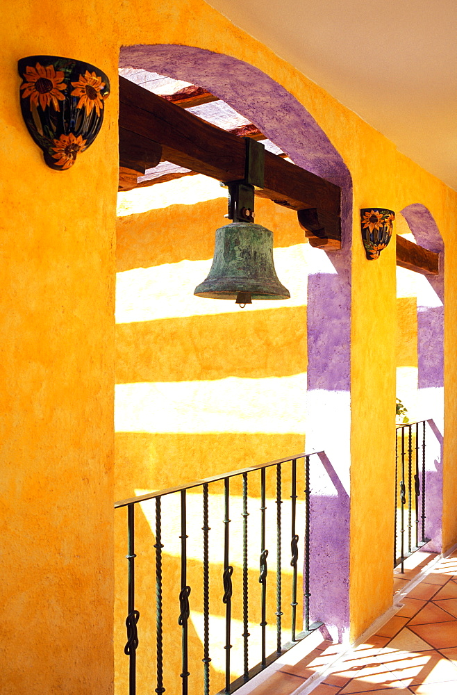 Colorful corridor in hotel with antique brass bell, Playa del Carmen, Yucatan, Mexico, North America - 818-549
