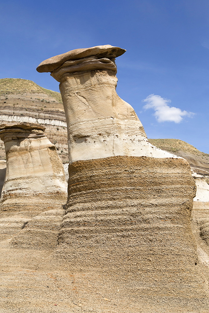 The hoodoos, rock formations formed by the erosion of Bentonite, in the Badlands close to Drumheller in Alberta, Canada, North America - 826-671
