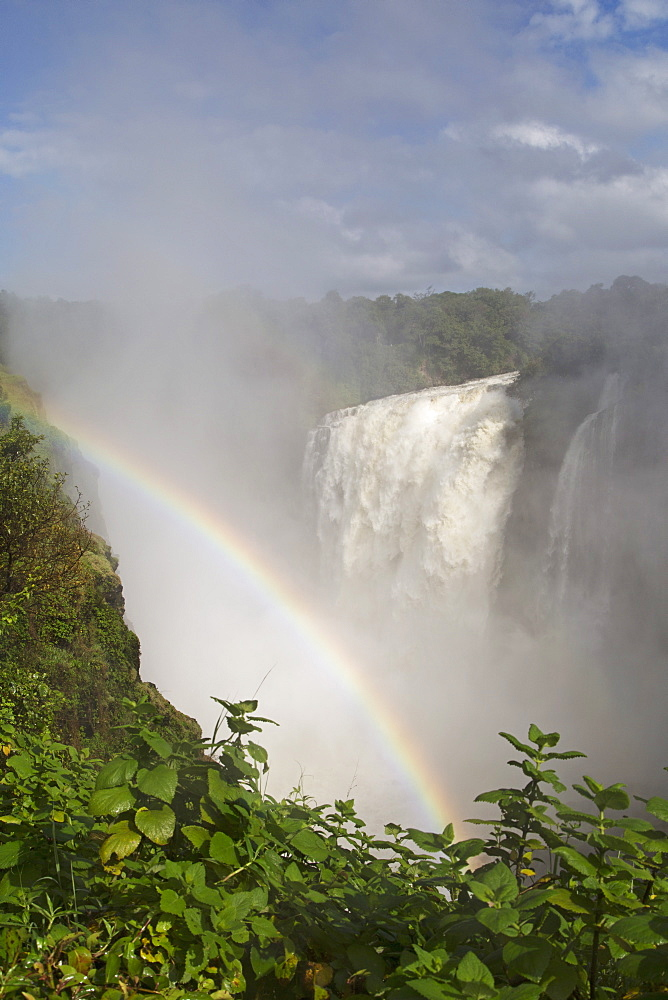 A rainbow in spray by the Victoria Falls waterfall (Mosi-oa-Tunya), UNESCO World Heritage Site, on the border of Zimbabwe and Zambia, Africa