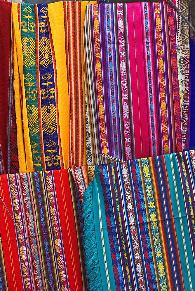 Colourful indigenous-style textiles on sale in the provincial capital, Riobamba, Chimborazo Province, Central Highlands, Ecuador, South America