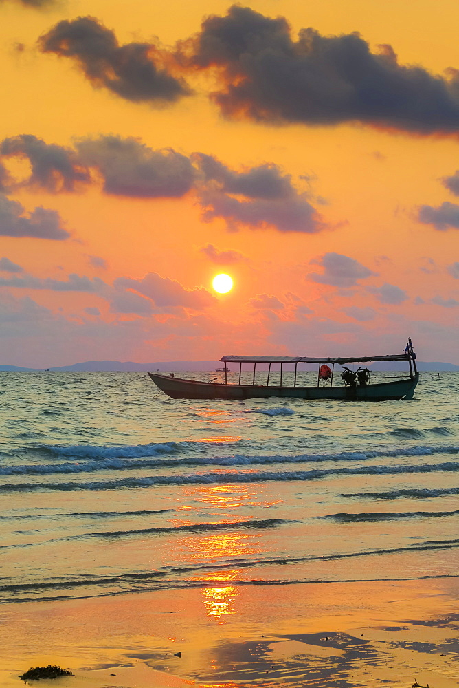 Fishing boat moored off this beach south of the city at sunset, Otres Beach, Sihanoukville, Cambodia
