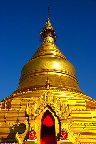 Golden stupa of Kuthodaw Paya against the blue sky Mandalay Burma