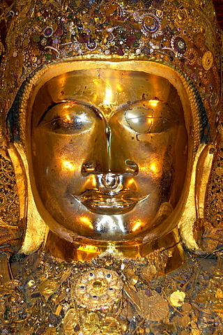 Portrait of the golden Mahamuni Buddha frontally Mandalay Burma