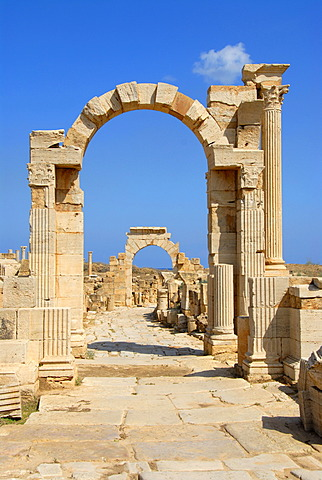 Two arches overstretch old Roman street cardo Leptis Magna Libya