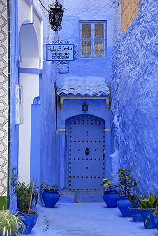 Luminous blue gate of Pension Cordoba medina Chefchaouen Morocco
