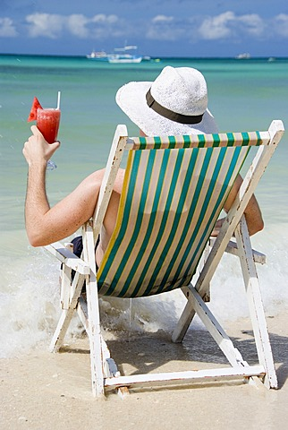 Man with cocktail at seashore
