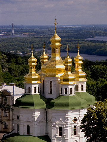Ukraine Kiev the monastery of cave Kyjevo Pecers´ka Lavra view to church of godmothers birth with shining golden domes and crosses in background river Dnepr 2004