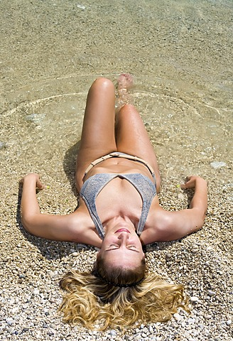 Woman relaxing on the beach, Korcula island, Dubrovnik Neretva, Dalmatia, Croatia, Europe
