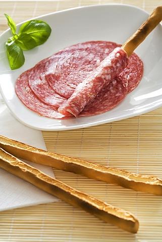 Breadsticks and salami slices